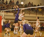 Brooklyn Kerbaugh gets up for a kill against Baldwin on Wednesday night during Tonganoxie's season-opening victory.