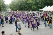 "Baldwin High School's football team makes the annual ""Bulldog Walk"" through the Bulldog Bash. Seniors Sam Foye and Camdon Schwartz lead the walk."