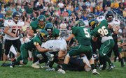 Bonner Springs quarterback Brandon Eastland is swarmed by the Basehor-Linwood defense during Basehor's 44-21 victory Friday.