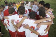 The Chieftains huddle up just before the start of their 4-1 victory over Piper on Wednesday night at Tonganoxie High.