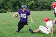 Baldwin Junior High School eighth grader Skyler Shockley returns Ottawa's kick off in the second quarter.