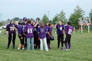 Members of the Baldwin Junior High School eighth grade football team take a moment to rest and drink water during a timeout Tuesday evening. BJHS beat Ottawa 14-8 to improve its record to 2-0 on the season.