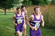 A trio of Baldwin High School boys' varsity runners pack up during Saturday's race. They are, from left, junior Carson Barnes, sophomore Tosh Mihesuah and junior Joey LaBuda.