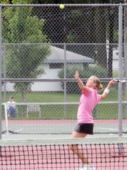Baldwin High School sophomore Hayley Schwartz serves the ball Saturday. Schwartz teamed up with sophomore Alison Berg to play No. 2 doubles. They placed fourth as a team.
