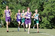 Baldwin High School's Brian Wright, left, and Tony Weiss, center, battle Free State's Logan Sloan, right, during Saturday's Baldwin Invitational. Sloan won the 5-kilometer race, as Weiss and Wright finished second and third.