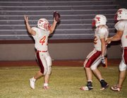 Jeremie Maus signals a touchdown after giving Tonganoxie High its first lead of the game on a seven-yard run in the fourth quarter. The Chieftains won at K.C. Wyandotte, 35-18.