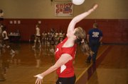 THS senior Ali George serves the ball during silver bracket play on Saturday at the Tonganoxie Invitational.