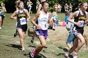 Baldwin High School freshman Sienna Durr, middle, finished 25th to earn a medal Saturday.