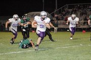 Baldwin High School junior Josh Hoffman runs 39 yards for the Bulldogs' only touchdown Friday night at De Soto.