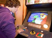 Jeff Dekeyser plays Capcom's Marvel Super Heroes Vs. Street Fighter at Doug'z Arcade. Dekeyser and other Tonganoxie youths come to the arcade after school.