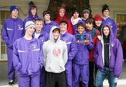 Baldwin High School boys' cross country team celebrates winning the Sabetha Invitational last Thursday.
