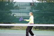 Baldwin High School sophomore Kara Hoegerl returns a volley Saturday during their final match.