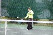 Baldwin High School junior Michaela Krysztof hits a ball over the net during her doubles' match Saturday.