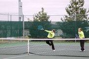 Baldwin High School junior Michaela Krysztof, left, spikes a ball over the net during a match Saturday. Her doubles' partner was sophomore Kara Hoegerl.