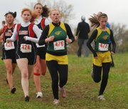 Basehor-Linwood's Shelby Miles (472) and Brooke Redmond (476) stuck together throughout the race Thursday at the Kaw Valley League Championships at Shawnee Mission Park.
