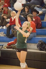 Basehor-Linwood's Macyn Sanders fires a serve during the Kaw Valley League Tournament. The Bobcats placed fourth.