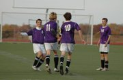 A trio of Baldwin High School players congratulate junior Will Nitcher (No. 11) after his first half goal Monday. Pictured, from left, are junior Joey Cool, senior Levi Moore and sophomore Clint Chapman.