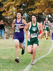 Baldwin High School sophomore Tosh Mihesuah, left, finished fourth at the Class 4A regional cross country meet.