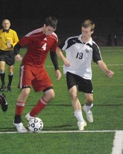 Tonganoxie senior defender Keaton Schaffer moves the ball away from Maranatha Academy's Connor Emberlin on Thursday during the Chieftains' 3-0 loss to the Eagles.