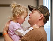 Jeff Sickman of Tonganoxie holds his daughter, Brooklyn, during a therapy session Saturday at Children's Mercy Hospital in Kansas City, Mo.