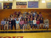 More than 140 former runners coached by Errol Logue gathered for a reunion Nov. 14 at Lansing High School to honor Logue, who has retired after 40 years of coaching at LHS.