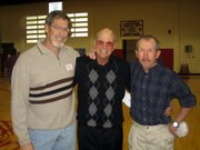 Mike Young, left, and Mike Utecht, right, visit with Coach Errol Logue. Young and Utecht were members of the first LHS cross country team coached byLoguein 1969.