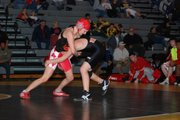 Danielle Mann (112) wrestled in the Tonganoxie High varsity lineup for the first time at Saturday's KVL duals.