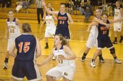 Logan Terry defends the ball as Cassidy Bristol denies the post for McLouth during a 30-point home victory on Thursday.