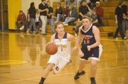 Terri Stewart drives past a Mustangs defender during McLouth's 59-29 win on Thursday.