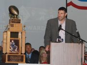 Mike Vrabel, a Kansas City Chiefs linebacker and three-time Super Bowl champion with the New England Patriots, was a guest speaker at the Simone Awards ceremony. The Thomas A. Simone Memorial Trophy can be seen at left. That trophy, which goes to the most outstanding football player in the Kansas City metro area, went to Olathe North senior running back James Franklin.