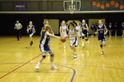 Baldwin Junior High School eighth grader Katie Jones, center, dribbles up court during a fast break last Thursday.