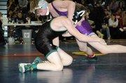 Baldwin High School freshman Bryce Shoemaker, right, won the 103-pound weight class Saturday at the Eudora Tournament of Champions.