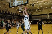 Baldwin High School senior Camdon Schwartz scores a layup during the first half Tuesday night.