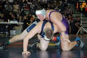 Baldwin High School junior Jesse Austin, right, placed sixth in the 285-pound weight class at the Eudora Tournament of Champions.