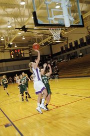 Baldwin High School junior Myranda Behrens scores a layup during the fourth quarter Tuesday.