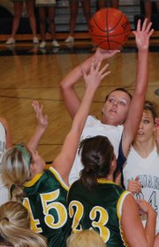 Mill Valley senior guard Whitney Hartman puts up a guarded jump shot during the Jaguars' 43-37 victory against Basehor-Linwood.