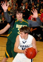 Mill Valley's JJ Bebel looks for room to operate while being defended closely by Basehor-Linwood's Richie O'Donnell. BLHS beat MVHS, 65-40.