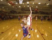 Lauren Hall, Tonganoxie High senior, draws contact at the basket after getting a steal in the final seconds of the first half against Santa Fe Trail on Friday. The Chieftains won, 40-35.