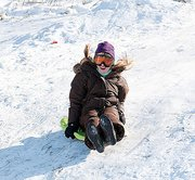 Riese Wismer, 11, enjoys the speedy Signal Oak hill while sledding on New Year's Eve.
