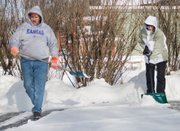 Fourth-grade teacher Kerry George and her father Gary Caldwell spend part of Thursday morning clearing George's driveway of snow.