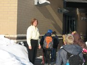 Principal Teri Boyd greets her students as they walk into their new building for the first time. 