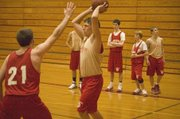 Austin Vickers looks to pass on Monday afternoon at Tonganoxie boys basketball practice.