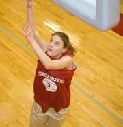 Haley Smith rises for a lay-up at Tonganoxie girls basketball practice on Monday. Winter weather kept the Chieftains off the court three days this past week.