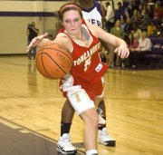 Andie Jeannin tries to save the ball from going out of bounds in Tonganoxie's 49-45 loss at Piper, in Kansas City, Kan., on Friday night.