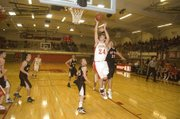 Tonganoxie senior Keaton Schaffer drives in for a layup in the second quarter of the Chieftains&#39; 60-50 win over Jeff West in the opening round of the Tonganoxie Invitational on Tuesday night. Schaffer led THS with 24 points, 13 rebounds and four assists.