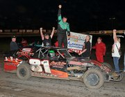 Danny Charles, of Basehor, celebrates a recent victory at Laskeside Speedway, a dirt race track located in Kansas City, Kan. Charles is one of several Basehor racecar drivers to be featured in an upcoming mini-series on the Discovery Channel.