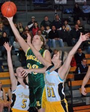 Basehor-Linwood junior Megan Bergstrom lays in a shot during the first quarter against St. Teresa's (Mo.) Academy.