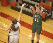 De Soto senior Tami Crow launches a three-pointer from the corner during the Wildcats' 61-56 victory over Jeff West on Thursday at the Tonganoxie Invitational.