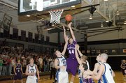 Baldwin High School junior Justin Vander Tuig (No. 44) skies above several Perry-Lecompton defenders to attempt a shot.