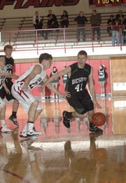 De Soto's Brandan Philbrook (41) drives to the lane as Eudora's Brian Katzfey defends. Philbrook scored 11 points for the Wildcats.